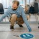Man applying social distancing stickers to floor