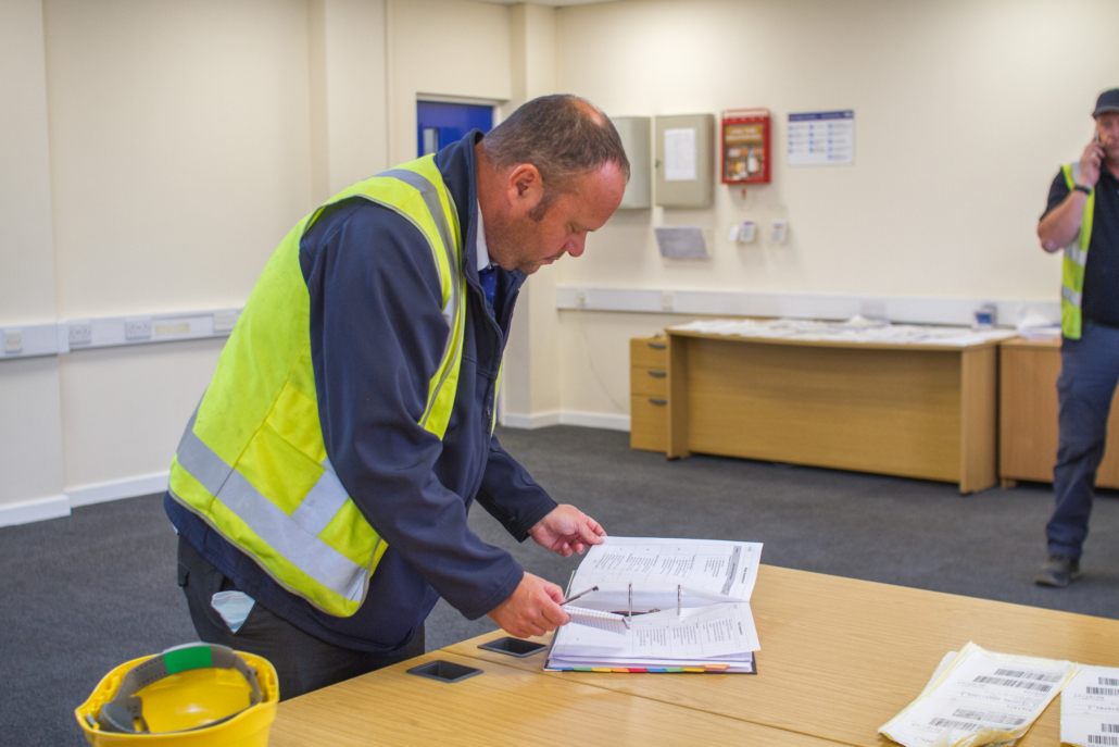 Worker looking through paperwork